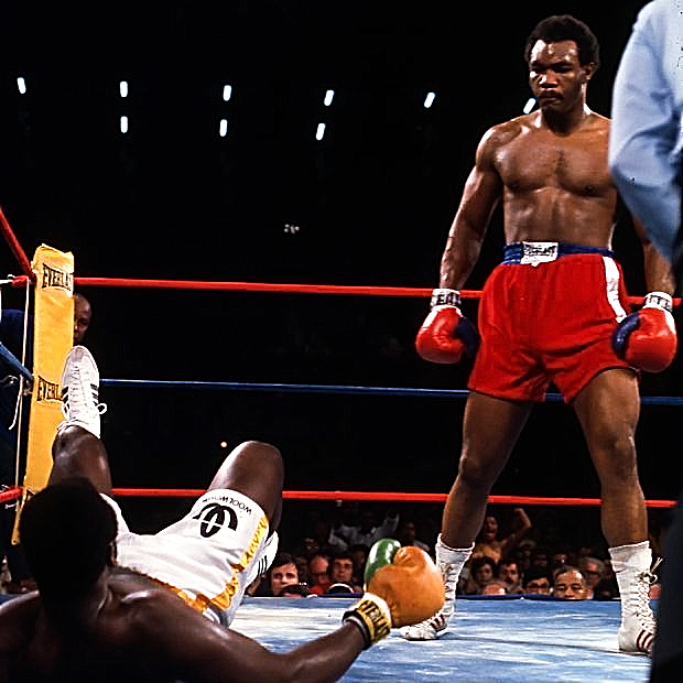 FOREMAN STANDING OVER FRAZIER